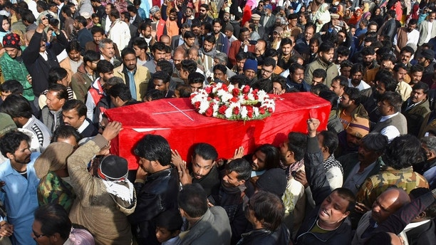 People attend a funeral as they carry the coffin of a victim who was killed after gunmen attacked the Bethel Memorial Methodist Church in Quetta, Pakistan December 18, 2017. REUTERS/Naseer Ahmed - RC113B29F0E0