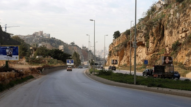 Cars pass near the area where British embassy worker Rebecca Dykes' body is believed to have been found by a main road outside Beirut, Lebanon December 18, 2017. REUTERS/Mohamed Azakir - RC1B7B1D33A0