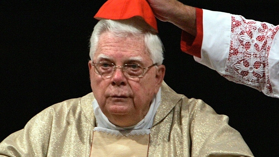 Cardinal Bernard Law has his skull cap adjusted during a ceremony in St. Mary Major's Basilica in Rome, Aug. 5, 2004.