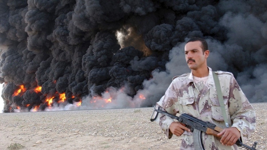 In this Sept. 13, 2005, file photo, an Iraqi soldier secures a burning pipeline near Kirkuk, 290 kilometers (180 miles) north of Baghdad, Iraq.