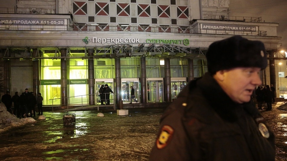 A policeman stands guard near a supermarket after an explosion in St Petersburg, Russia on Wednesday.
