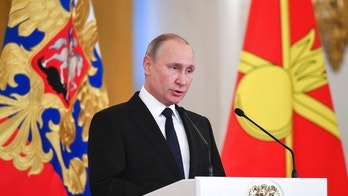 Russian President Vladimir Putin delivers a speech during an award ceremony in the Kremlin, in Moscow, Russia, Thursday, Dec. 28, 2017, for Russian Armed Forces service personnel who took part in the anti-terrorist operation in Syria. Putin said at Thursday's award ceremony that Wednesday's explosion at a supermarket in the country's second-largest city was a terrorist attack. (Kirill Kudryavtsev/Pool Photo via AP)