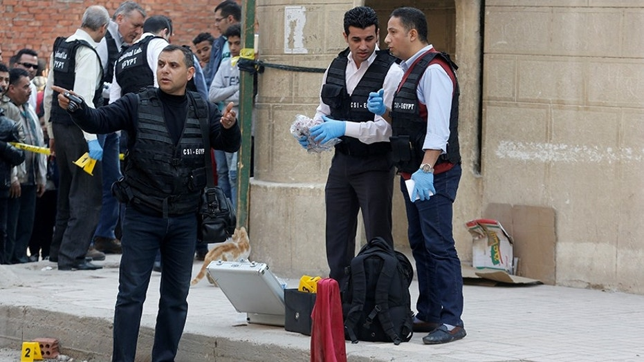 Police inspect the site of an attack on a church in the Helwan district south of Cairo Egypt