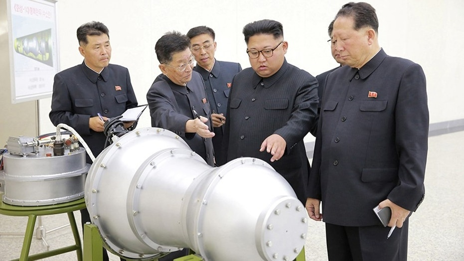 North Korean leader Kim Jong Un provides guidance with Ri Hong Sop and Hong Sung Mu on a nuclear weapons program in this undated photo.