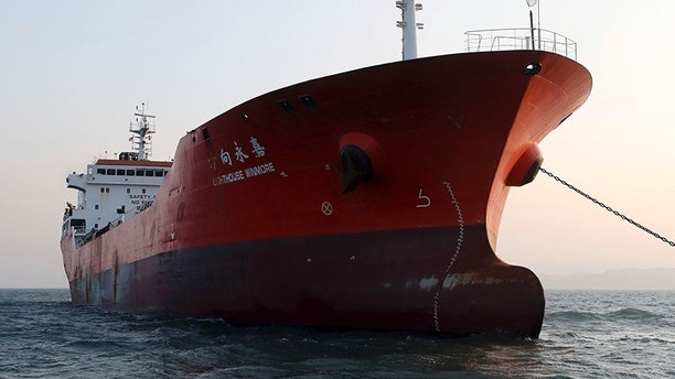 The Lighthouse Winmore, a Hong Kong-flagged ship, is seen in waters off Yeosu, South Korea, Friday, Dec. 29, 2017. South Korean authorities boarded the Hong Kong-flagged ship and interviewed its crew members for allegedly violating U.N. sanctions by transferring oil to a North Korean vessel in October, an official said Friday. (Hyung Min-woo/Yonhap via AP)