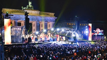 FILE - In this Dec. 31, 2016 file photo numerous visitors stand in front of the stage at the Brandenburg Gate where the New Year's Eve party is taking place in Berlin, Germany. The head of a German police union DpolG Rainer Wendt is criticizing Saturday, Dec. 31, 2017, the creation of a special safe zone for women at the annual New Year's Eve party in front of Berlin's iconic Brandenburg Gate. (Jens Kalaene/dpa via AP, file)