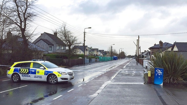 Irish police close a road at the scene where a man has died and two others were injured after a stabbing attack Dundalk, Ireland Wednesday Jan. 3, 2018. Irish media said the stabbing victim is a Japanese man who was attacked on the street and stabbed in the back. (David Young/PA via AP)