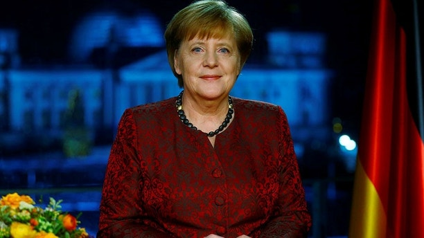 ATTENTION: EMBARGOED FOR PUBLICATION UNTIL 30 DECEMBER 11:00 PM GMT! - BLOCKING PERIOD - The photograph may not be published before the 30th of December 2017, 11:00 PM GMT.      German acting Chancellor Angela Merkel poses for photographs after the television recording of her annual New Year's speech at the Chancellery in Berlin, Germany, December 30, 2017. REUTERS/Hannibal Hanschke - RC1524043840