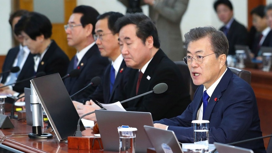South Korean President Moon Jae-in, right, speaks during a cabinet meeting at the presidential Blue House in Seoul, South Korea, Tuesday, Jan. 2, 2018. South Korea on Tuesday offered high-level talks with rival North Korea to find ways to cooperate on next month's Winter Olympics in the South. (Kim Ju-hyoung/Yonhap via AP)