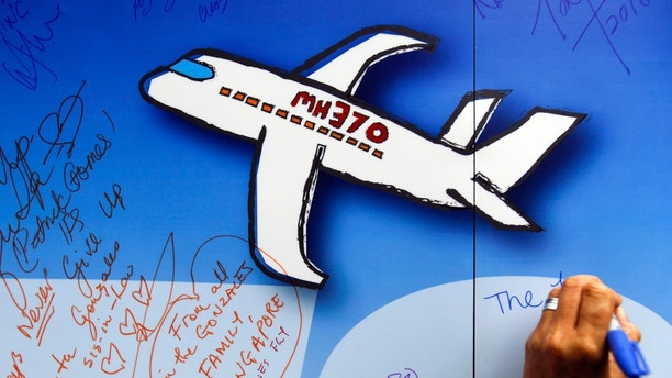 Malaysia OKs new search by private company for missing plane