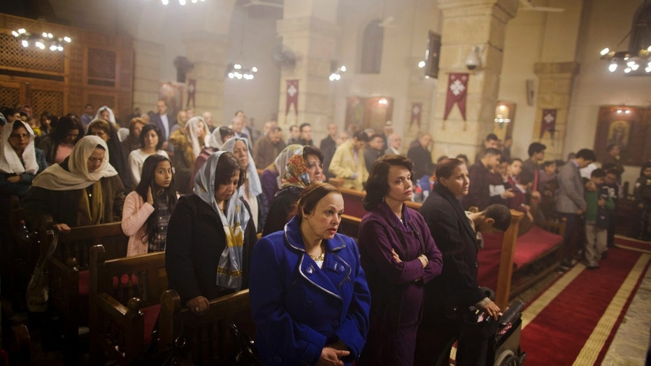 Coptic Christians pray during Christmas Eve Mass at the Virgin Mary church, in Cairo, Egypt, late Saturday, Jan. 6, 2018.