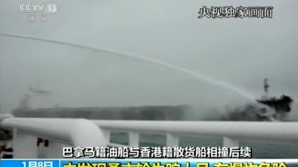 "In this image made from video run by China's CCTV, a rescue ship sprays water to put out a blaze at the Panama-registered tanker ""Sanchi"" after a collision with a Hong Kong-registered freighter off China's eastern coast, Monday, Jan. 8, 2017. The U.S. Navy has joined the search for 32 crew members missing from the oil tanker that caught fire after colliding with a bulk freighter off China's east coast. (CCTV via AP Video)"
