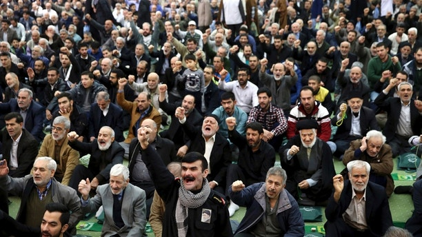 Iranian worshippers chant slogans during the Friday prayer ceremony in Tehran, Iran, Jan. 5, 2018. A hard-line Iranian cleric has called on Iran to create its own indigenous social media apps, blaming them for the unrest that followed days of protest in the Islamic Republic over its economy. (AP Photo/Ebrahim Noroozi)