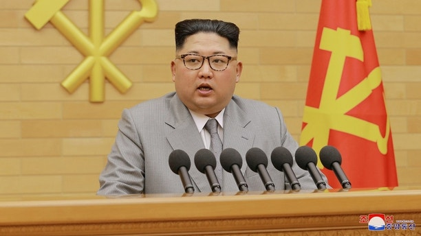 North Korea's leader Kim Jong Un speaks during a New Year's Day speech in this