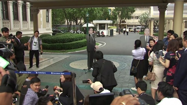 "In this image from video, a life-sized cardboard cut-out figure of Thailand's Prime Minister Prayuth Chan-ocha, stands next to the microphone and faces the media after the Prime Minister left the scene, in Bangkok, Thailand, Monday Jan. 8, 2018.  Prayuth evaded questions by bringing out a life-sized cardboard cut-out of himself, and telling reporters to ""ask this guy"" if they had ""any questions on politics or conflict"", he then turned on his heel and walked off, leaving the mock-up behind, to bemused looks and awkward laughter from the assembled media. (TPBS via AP)"