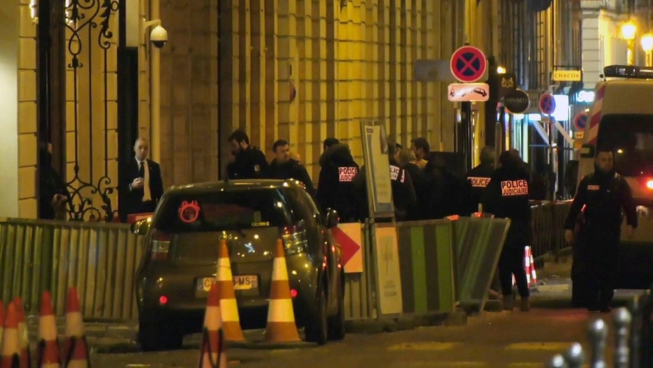 In this image made from video, French police attend the scene outside the Ritz Hotel in Paris, France, after a robbery Wednesday evening Jan. 10, 2018.