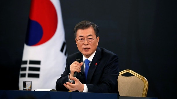 South Korean President Moon Jae-in answers reporters' question during his New Year news conference at the Presidential Blue House in Seoul, South Korea, January 10, 2018.  REUTERS/Kim Hong-Ji - RC1979292290