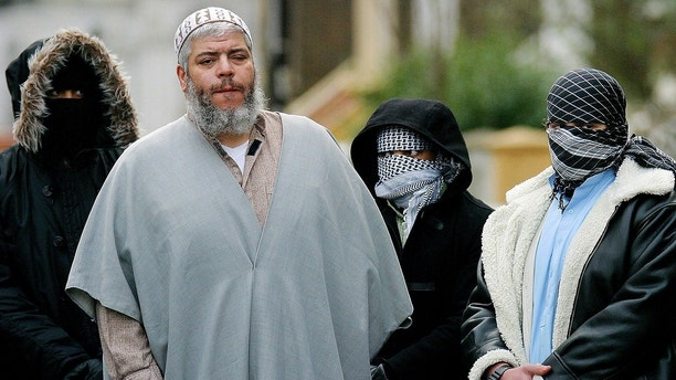 - FILE PHOTO TAKEN 07FEB03 - A file photograph dated February 7, 2003 shows Muslim cleric Sheikh Abu Hamza (2L) outside the North London Mosque at Finsbury Park surrounded by supporters. British police arrested Hamza on an extradition warrant from the United States, a spokeswoman said on May 27, 2004. - PBEAHUOIVGH