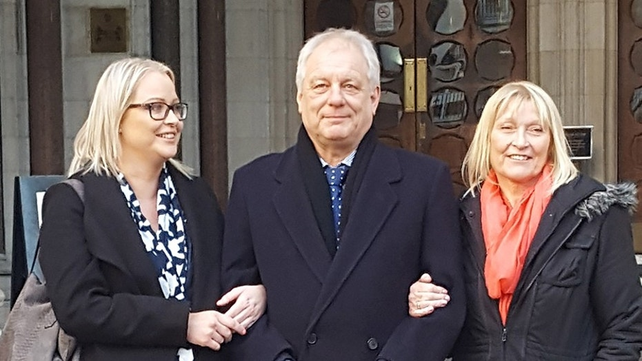 Stephen Simmons, center, was overjoyed in court Wednesday after his theft conviction from the 1970s was overturned by the United Kingdom's Court of Appeals.