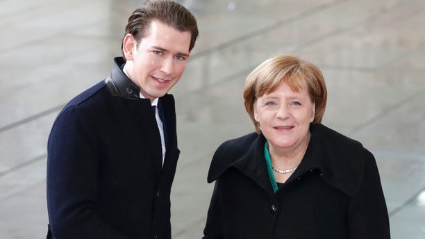 German Chancellor Angela Merkel, right, welcomes the Chancellor of Austria, Sebastian Kurz, left, with military honors for a meeting at the chancellery in Berlin, Germany, Wednesday, Jan. 17, 2018. (AP Photo/Michael Sohn)