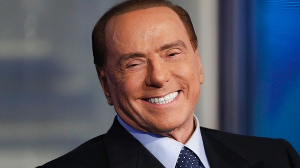 Italian former Prime Minister and Forza Italia (Go Italy) party leader, Silvio Berlusconi, smiles during the recording of the Italian state television RAI, Porta a Porta (Door To Door) talk show in Rome, Thursday, Jan. 11, 2018. (AP Photo/Andrew Medichini)