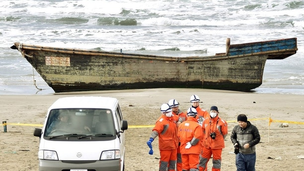 A wooden boat, which drifted ashore with eight partially skeletal bodies and was found by the Japan Coast Guard, is seen in Oga, Akita Prefecture, Japan, in this photo taken by Kyodo on November 27, 2017. Mandatory credit Kyodo/via REUTERS ATTENTION EDITORS - THIS IMAGE WAS PROVIDED BY A THIRD PARTY. MANDATORY CREDIT. JAPAN OUT. NO COMMERCIAL OR EDITORIAL SALES IN JAPAN. - RC1916E90BA0