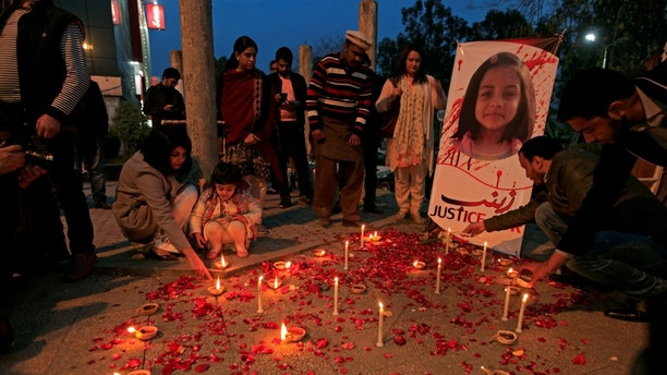 FILE PHOTO: Members of Civil Society light candles and earthen lamps to condemn the rape and murder of 7-year-old girl Zainab Ansari in Kasur, during a candlelight vigil in Islamabad, Pakistan January 11, 2018. REUTERS/Faisal Mahmood/File Photo - RC18752F1F80