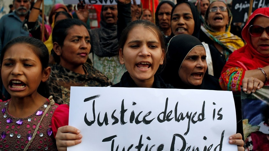A girl holds a sign while chanting to condemn the rape and killing of 7-year-old Zainab Ansari during a protest in Karachi, Pakistan, Jan. 13, 2018.