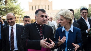 German Defence Minister Ursula von der Leyen (R) and Iraqi Archbishop Bashar Warda (C) the Chaldean Archbishop of Arbil, visit St. Josef Kirche in Ankawa near Arbil north of Baghdad September 25, 2014.  REUTERS/Maja Hitij/Pool (IRAQ  - Tags: POLITICS MILITARY)   - RTR47PAB
