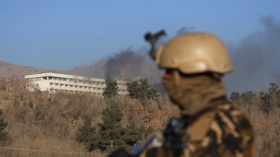 Black smoke rises from the Intercontinental Hotel after an attack in Kabul, Afghanistan, Jan. 21, 2018.