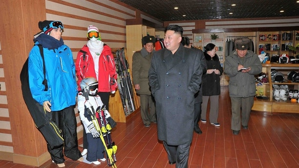 North Korean leader Kim Jong Un (front) visits the Masik-Ryong Ski Resort, which is near completion, near Wonsan in this undated photo released by North Korea's Korean Central News Agency (KCNA) in Pyongyang December 15, 2013. REUTERS/KCNA (NORTH KOREA - Tags: POLITICS TRAVEL) ATTENTION EDITORS - THIS PICTURE WAS PROVIDED BY A THIRD PARTY. REUTERS IS UNABLE TO INDEPENDENTLY VERIFY THE AUTHENTICITY, CONTENT, LOCATION OR DATE OF THIS IMAGE. FOR EDITORIAL USE ONLY. NOT FOR SALE FOR MARKETING OR ADVERTISING CAMPAIGNS. THIS PICTURE IS DISTRIBUTED EXACTLY AS RECEIVED BY REUTERS, AS A SERVICE TO CLIENTS. NO THIRD PARTY SALES. NOT FOR USE BY REUTERS THIRD PARTY DISTRIBUTORS. SOUTH KOREA OUT. NO COMMERCIAL OR EDITORIAL SALES IN SOUTH KOREA - GM1E9CF149K01