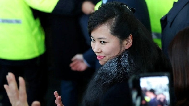 FILE - In this Sunday, Jan. 21, 2018, file photo, North Korean Hyon Song Wol, head of North Korea's art troupe, waves as she arrives at the Gangneung Railway Station in Gangneung, South Korea. Hyon, the photogenic leader of Kim Jong Un's hand-picked Moranbong Band, has made two excursions across the Demilitarized Zone as a negotiator and advance team leader working out the details of Kim's surprise offer for the North to participate in the Pyeongchang Games. South Korea's media have been treating her like a true K-pop celebrity. (Kim In-chul/Yonhap via AP, File)