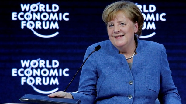 German Chancellor Angela Merkel smiles during the World Economic Forum (WEF) annual meeting in Davos, Switzerland January 24, 2018.  REUTERS/Denis Balibouse - RC1BBE728260