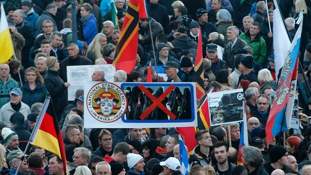 People gather for an anti-immigration demonstration organised by rightwing movement Patriotic Europeans Against the Islamisation of the West (PEGIDA) in Dresden, Germany October 19, 2015. PEGIDA held a rally on Monday to mark the one-year anniversary of the group's formation.     REUTERS/Fabrizio Bensch - LR1EBAJ19IXEH