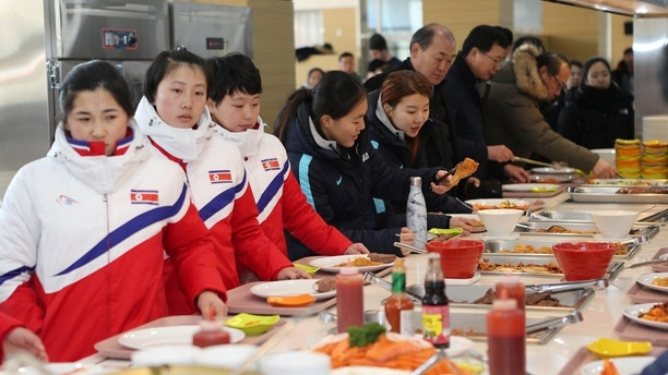 North and South Korea women's ice hockey athletes stand in a line at a dining hall at the Jincheon National Training Centre in Jincheon, South Korea January 25, 2018. The Ministry of Culture, Sports and Tourism/Yonhap via REUTERS      ATTENTION EDITORS - THIS IMAGE HAS BEEN SUPPLIED BY A THIRD PARTY. SOUTH KOREA OUT. NO RESALES. NO ARCHIVE. - RC1A7207B5C0