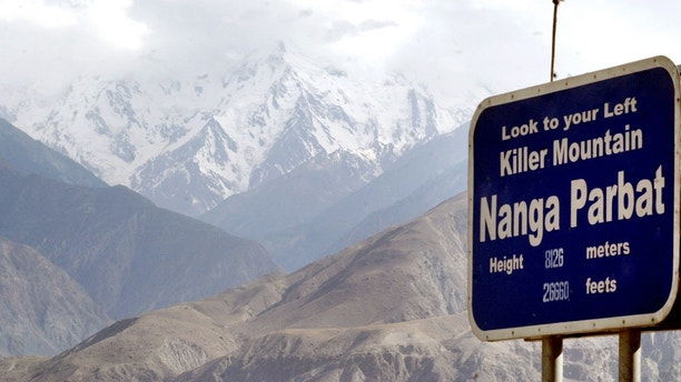 Snow packed mountain of northern Pakistan is seen in this July 14 2004 file photo. Hopes are fading of finding alive one of Latin America's leading climbers after he went missing 10 days ago on Nanga Parbat, the world's ninth highest peak, Pakistani rescuers said on Saturday. Picture taken July 14, 2004. REUTERS/Faisal Mahmood(PAKISTAN) - GM1DTCJOEFAA