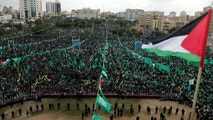 A Palestinian flag flies as Hamas supporters take part in a rally marking the 30th anniversary of Hamas' founding, in Gaza City December 14, 2017. REUTERS/Suhaib Salem - RC19EF93D000