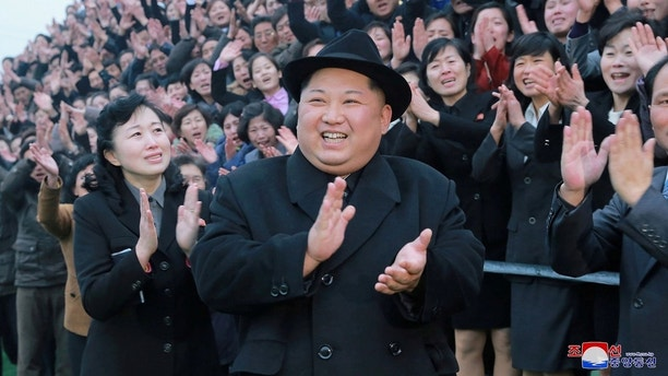 North Korean leader Kim Jong Un reacts as people applaud during his visit to the newly-remodeled Pyongyang Teacher Training College, in this photo released by North Korea's Korean Central News Agency (KCNA) in Pyongyang on January 17, 2018.   KCNA/via REUTERS   ATTENTION EDITORS - THIS PICTURE WAS PROVIDED BY A THIRD PARTY. REUTERS IS UNABLE TO INDEPENDENTLY VERIFY THE AUTHENTICITY, CONTENT, LOCATION OR DATE OF THIS IMAGE. NO THIRD PARTY SALES. SOUTH KOREA OUT.     TPX IMAGES OF THE DAY - RC176CC4E2F0