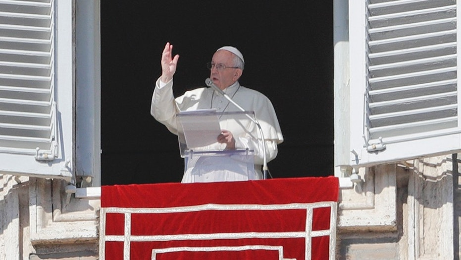 Feb. 4, 2018: Pope Francis delivers a blessing from his studio's window overlooking St. Peter's Square on the occasion of the Angelus noon prayer at the Vatican.