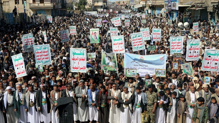 "Followers of the Houthi movement rally to mark the 'Martyr Day' in Saada, Yemen February 5, 2018. The placards read: ""Allah is the greatest. Death to America, death to Israel, a curse on the Jews, victory to Islam."" REUTERS/Naif Rahma - RC19C29CE220"