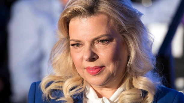 FILE - In this Sunday, May 21, 2017 file photo, Sara Netanyahu the wife of Israeli Prime Minister Benjamin Netanyahu attends a ceremony celebrating the 50th anniversary of the liberation and unification of Jerusalem, in Jerusalem. A recording of Benjamin Netanyahu's wife raging at an aide surfaced on Sunday creating a new headache for Israel's embattled premier. Sara Netanyahu is heard complaining that a gossip column about her did not mention her educational credentials. (Abir Sultan, Pool Photo via AP, File)