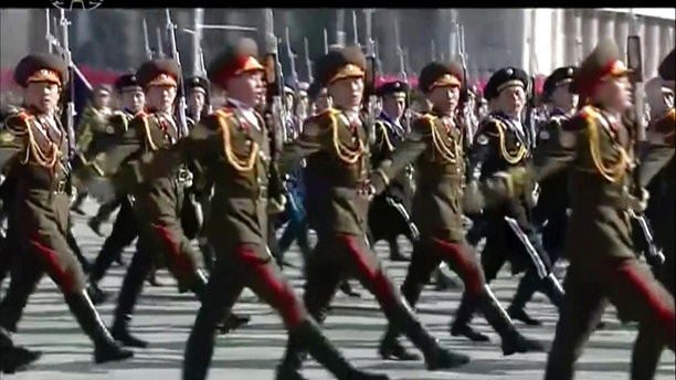 In this image made from video released by KRT,  North Korean soldiers march during a military parade in Pyongyang, Thursday, Feb. 8 2018.  North Korea held a military parade and rally on Kim Il Sung Square on Thursday, just one day before South Korea holds the opening ceremony for the Pyeongchang Winter Olympics. (KRT via AP Photo)
