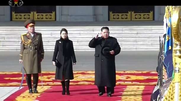 In this image made from video released by KRT on Feb. 8, 2018,  North Korean leader Kim Jong Un, right, inspects honor guards, along with his wife Ri Sol Ju, center,  during a military parade in Pyongyang, Thursday, Feb. 8 2018.  North Korea held a military parade and rally on Kim Il Sung Square on Thursday, just one day before South Korea holds the opening ceremony for the Pyeongchang Winter Olympics. (KRT via AP Photo)