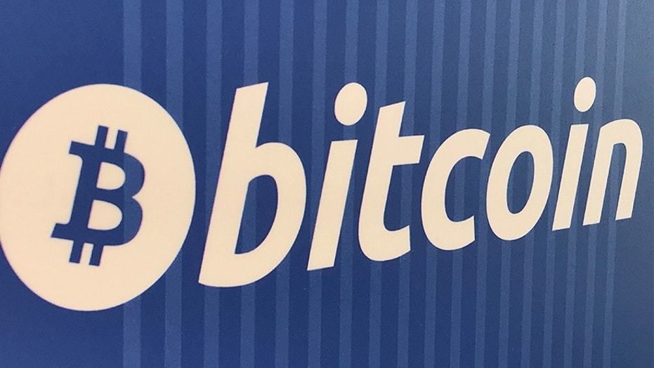 Russian nuclear scientists busted for plot to acquire bitcoins a bitcoin logo is seen on a cryptocurrency atm ccuart Choice Image