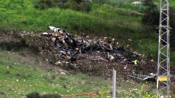 """In this image made from video provided by Yehunda Pinto, the wreckage of a jet is seen near Harduf, northern Israel, Saturday, Feb. 10, 2018. The Israeli military shot down an Iranian drone that infiltrated the country early Saturday before launching a """"large-scale attack"""" on at least a dozen Iranian and Syrian targets in Syria. Israel called it a """"severe and irregular violation of Israeli sovereignty"""" and warned of further action against the unprecedented Iranian aggression. (Yehunda Pinto via AP)"""