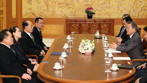 South Korean President Moon Jae-in, third from right, speaks to Kim Yo Jong, second from left, sister of North Korean leader Kim Jong Un, and North Korean delegation during a meeting at the presidential house in Seoul, South Korea, Saturday, Feb. 10, 2018. South Korean President Moon is hosting lunch for the senior North Korean officials in the most significant diplomatic encounter between the rivals in years.  (Kim Ju-sung/Yonhap via AP)