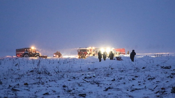 In this photo provided by the Russian Emergency Situations Ministry, Russian Ministry for Emergency Situations employees work at the scene of a AN-148 plane crash in Stepanovskoye village, about 40 kilometers (25 miles) from the Domodedovo airport, Russia, Sunday, Feb. 11, 2018. Russia's Emergencies Ministry says a passenger plane has crashed near Moscow and fragments of it have been found. Russian officials say all passengers aboard the airliner that has crashed outside Moscow are believed to have been residents of the region that was the plane's destination. No survivors have been reported. (Russian Ministry for Emergency Situations photo via AP)