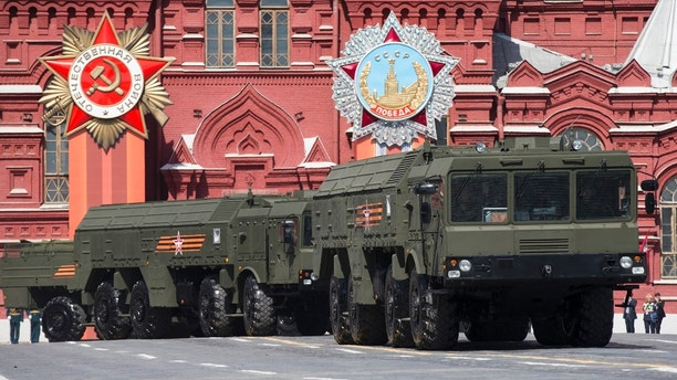 "FILE - In this Saturday, May 9, 2015 file photo, Iskander missile launchers are driven during the Victory Parade marking the 70th anniversary of the defeat of the Nazis in World War II, in Red Square in Moscow. Lithuania's president says Russia has deployed additional nuclear-capable missiles in its Baltic Sea exclave of Kaliningrad on a permanent basis, calling it a threat to Europe. Dalia Grybauskaite told reporters Monday, Feb. 5, 2018 after visiting NATO troops in the town of Rukla that ""Iskander missiles are being stationed in Kaliningrad for permanent presence as we speak.""  (AP Photo/Alexander Zemlianichenko, file)"