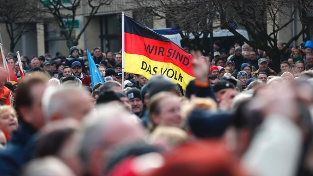 "People attend a demonstration against migrants in Cottbus, Germany February 3, 2018.  Sign reads ""We are the people"". REUTERS/Hannibal Hanschke - UP1EE2310Q55O"