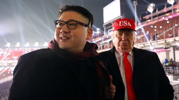 People dressed-up as U.S. President Donald Trump and North Korean leader Kim Jong Un attend the Winter Olympics opening ceremony in Pyeongchang, South Korea February 9, 2018.  Yonhap via REUTERS   ATTENTION EDITORS - THIS IMAGE HAS BEEN SUPPLIED BY A THIRD PARTY. SOUTH KOREA OUT. NO RESALES. NO ARCHIVE. - RC17F5232260